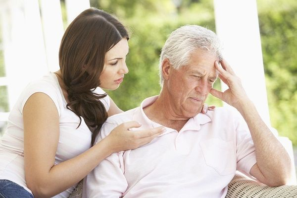 Adult Daughter Talking To Depressed Senior Father